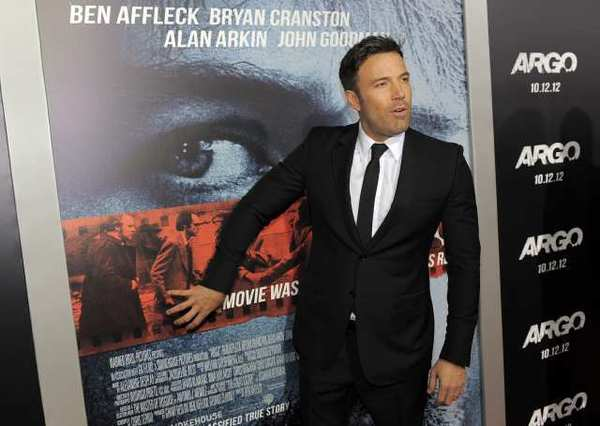 "Ben Affleck, director, producer and a cast member of the film ""Argo,"" poses at the premiere of the film at The Academy of Motion Picture Arts & Sciences."
