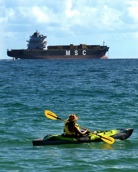 A woman paddles in her kayak off Fort Lauderdale's beach.