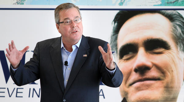 "Former Florida governor Jeb Bush campaigns for Mitt Romney at a ""Small Business Victory Town Hall"" meeting at Orlando Executive Airport, in Orlando, Fla., Tuesday, October 9,  2012."