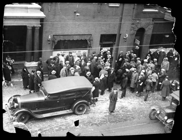 "A crowd outside the North Clark Street garage, owned by George ""Bugs"" Moran, where the St. Valentine's Day massacre took place on Feb. 14, 1929. Seven were murdered in conflict between gangs during Prohibition. Al Capone is believed to have orchestrated the event."
