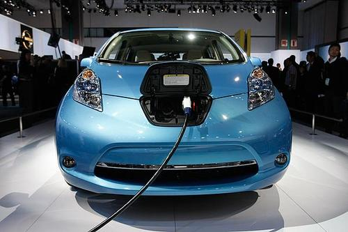 """A Nissan Leaf ready for a charge is shown at the 2010 L.A. Auto Show.  <br> <a href=""""http://www.latimes.com/business/autos/la-fi-nissan-leaf-review-20101209,0,4286363.story""""><u>See full story</u></a>"""