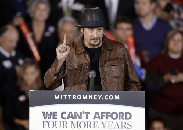 Pop music star Kid Rock speaks before introducing Republican vice presidential nominee Paul Ryan at a rally at Oakland University in Rochester, Mich.