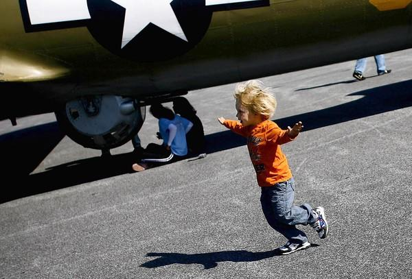 A youngster pretends to be an airplane while checking out the Wings of Freedom Tour at the Carroll County Regional Airport in Westminster in this file photo. The tour makes its return to Westminster Oct. 12-15.