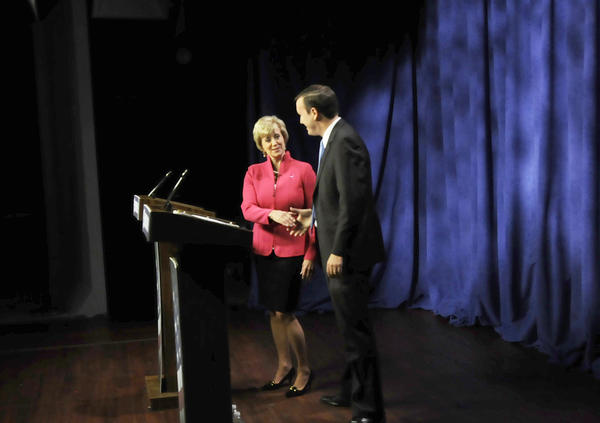 Senate candidates Linda McMahon and Chris Murphy shake hands before their debate begins at WFSB in Rocky Hill Oct. 7.