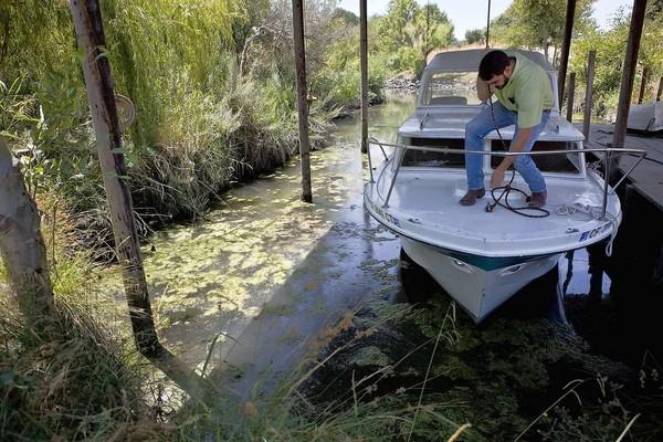 Farmer Brett Baker prepares for a boat ride on portions of the Sacramento-San Joaquin River Delta.