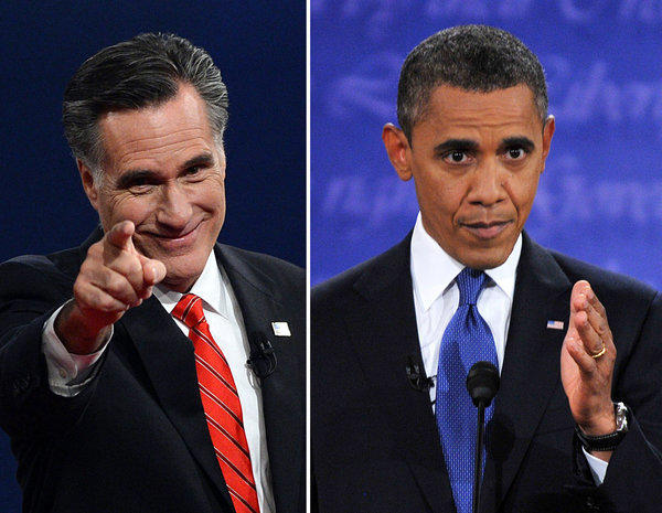 President Obama, right, speaks during his debate with Republican Presidential candidate Mitt Romney, who greets the audience at the conclusion in Denver, Colo.