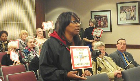Wanda Barber of Hagerstown was one of several people holding signs and speaking in favor of a proposed Washington County senior citizen center during Tuesday's Washington County Board of Commissioners meeting.