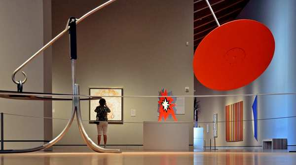 "Alexander Calder's ""Trois noirs sur un rouge"" (foreground). The museum's collection spans five centuries, from Colonial works to the present day."