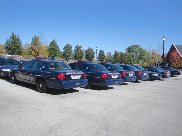 Police cars line up in the Arlington Heights Police Department parking lot.