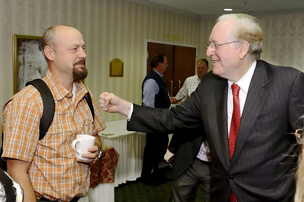 Matt Knott, owner of River Riders in Harpers Ferry, W.Va., gets a fist bump on the chest Tuesday by U.S. Sen. Jay Rockefeller, D-W.Va., before he spoke at the Governor's Conference on Tourism at the Clarion Hotel and Conference Center in Shepherdstown, W.Va.