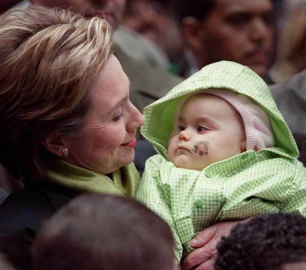 Hillary Rodham Clinton was campaigning for the U.S. Senate in March 2000 in New York City when she bussed a green-swaddled baby at the city's St. Patrick's Day parade. Maybe it conveyed good luck -- or is that legend about a leprechaun, not a baby?