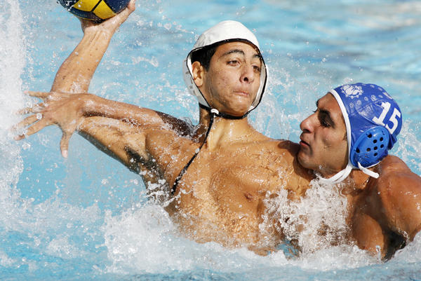 Hoover's Hakop Baghumian attempts to shoot against Burbank's Arman Toresian who's defense does enough to tangle the shot in a Pacific League boys water polo match at Burbank High School on Tuesday, October 9, 2012.