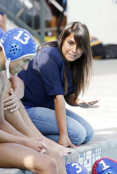 Burbank coach Kristina Garcia talks to her team during a timeout in a game against Hoover in a Pacific League boys water polo match at Burbank High School on Tuesday, October 9, 2012.