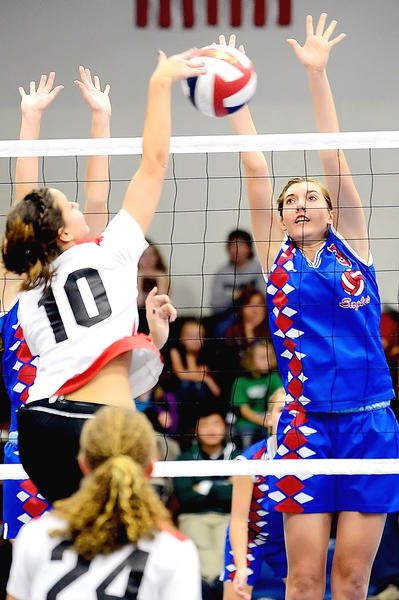 Heritage Academy's Christi Jackson, right, blocks the kill attempt of Cumberland Valley Christian's Marin Kearns (10) during Tuesday night's Mason Dixon Christian Conference volleyball match at Heritage.