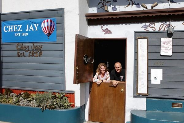 Anita Fiondella Eck, left, and Michael Anderson are two of the three owners of Chez Jay on Ocean Boulevard in Santa Monica. The third, not shown, is Chaz Fiondella.