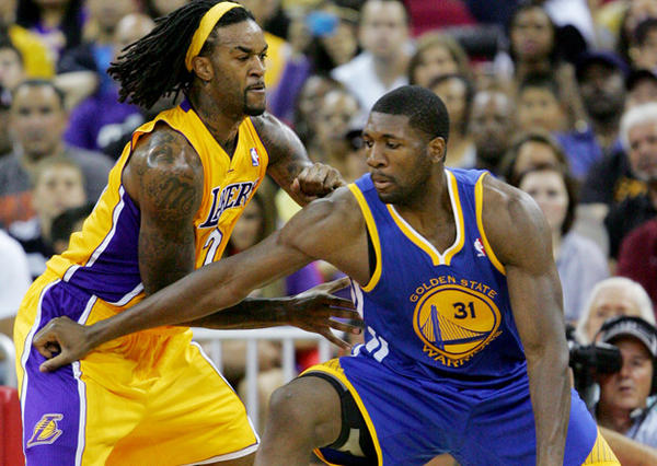 Jordan Hill defends against Golden State Warriors rookie Festus Ezeli.