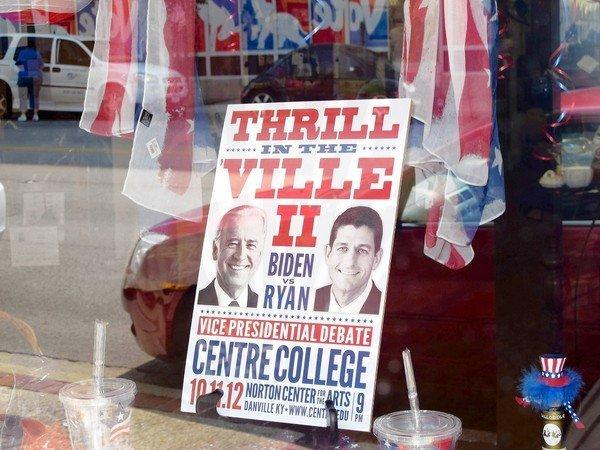 A sign in a business in downtown Danville, Ky., spotlights this week's vice presidential debate in town.
