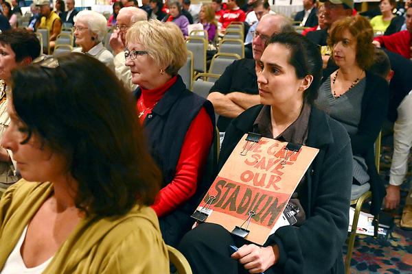 Julie Rivett, a resident on Summit Avenue in Hagerstown, holds a sign in favor of saving Municipal Stadium while attending a public information session with the Hagerstown City Council at Hager Hall Conference and Events Center Tuesday.