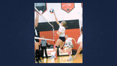 Shade's Kaily Karl works near the net at Meyersdale on Tuesday.