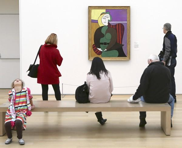 """Red Armchair,"" a painting by Pablo Picasso, attracts visitors Tuesday in the Modern Wing of the Art Institute."