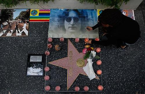 Scotti Boettner lights candles as fans gather outside the Capitol Records building to celebrate John Lennon's birthday.