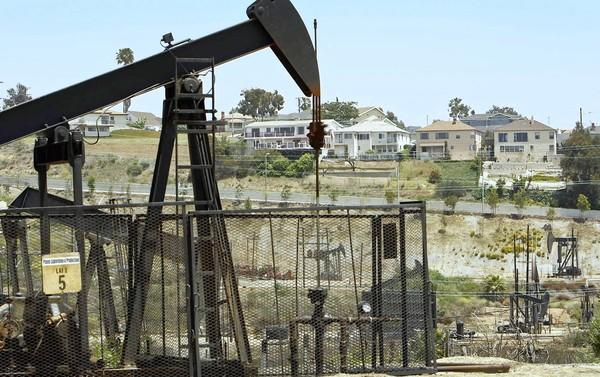 Homes overlook the Inglewood Oil Field -- the largest urban oil field in the country -- operated by Plains Exploration & Production Co. Neighbors have been concerned about the possible ramifications of the fracking method of extraction.