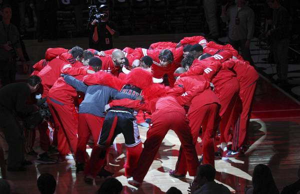 Chicago Bulls players huddle before the start of their preseason game against the Memphis Grizzlies at the United Center in Chicago.