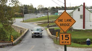 Two officials with the Washington County Division of Public Works outlined plans Tuesday night for the rehabilitation of the Coffman Farms Road Bridge over Little Antietam Creek near town hall.