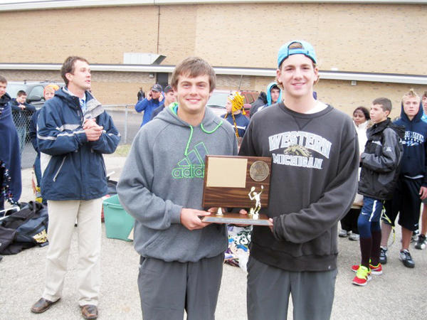 Petoskey senior tennis captains Brandon Pomranke (left) and Zach Phillips hold the Big North Conference tournament trophy Tuesday in Cadillac.