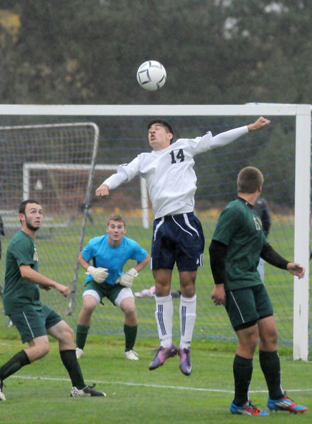 Petoskey sophomore Griffin Christensen (14) heads the ball near the Traverse City West goal Tuesday during a Big North Conference match at the Click Road Soccer Complex. The Titans defeated the Northmen, 2-1.