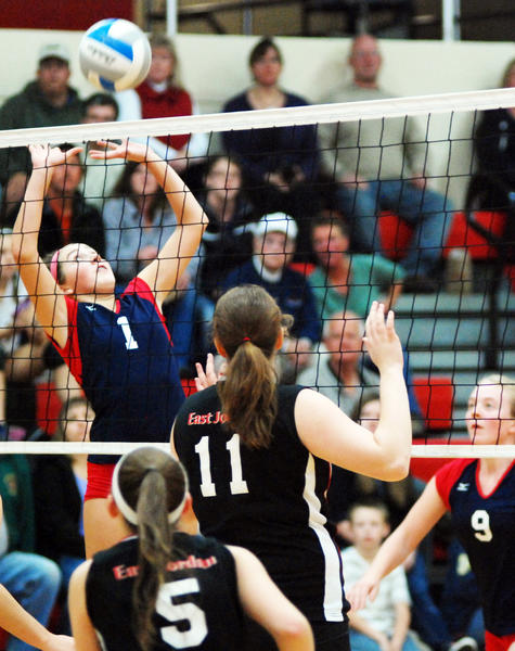 Boyne City's Heather Nichols (left) sets the ball against East Jordan during a Lake Michigan Conference match Tuesday at the East Jordan High School gym.