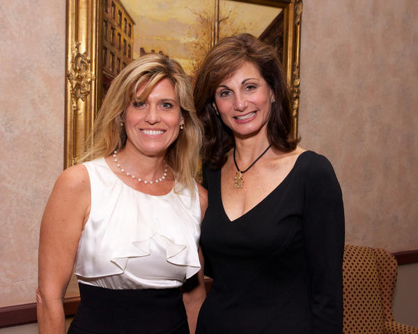 "Babette Ferre-Kosar, left, and Corinne Cott promote the JFS (Jewish Family Service) KOLOT Coalition's annual ""Luncheon and Fashion Show,"" which will take place on Oct. 28 at the Signature Grand. The luncheon titled, ""Breaking the Silence – Dating Abuse: It's Not Love,"" is part of the community-wide campaign to engage people of all ages as allies in ending forms of abuse against women and girls."