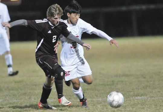 Clark junior Frankie Kao (32) battles Bourbon County¿s Jonathan Creamer for possession of the ball in a 1-0 triumph over the Colonels Tuesday night at Stonerside Field in Paris.