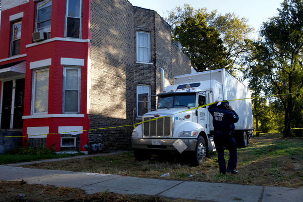 Police check the truck, parked in vacant lot in the 5800 block of South Aberdeen Street, where at about 8:15 p.m. Tuesday Canadian truck driver Gary Clark, 39, was shot and killed during a apparent robbery attempt.