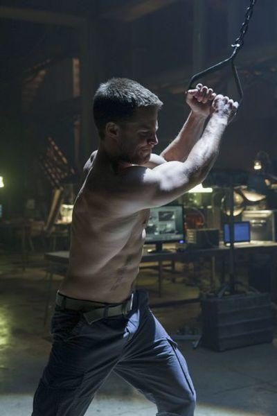 "Stephen Amell got into his ""Arrow"" shape with the help of stunt coordinator James Bamford. Amell, who does a ton of his own stunts, is shown here working out as Oliver Queen."