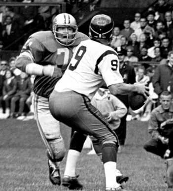 Detroit Lions' defensive tackle Alex Karras (71) takes aim at Washington Redskins'  quarterback Sonny Jurgensen in an Oct. 3, 1965, game at Tiger Stadium in Detroit.