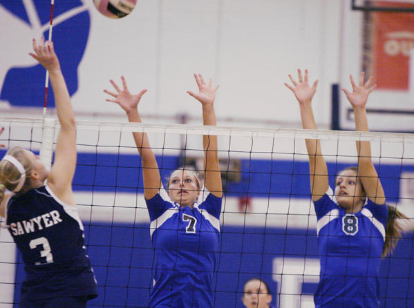 Apopka High's Kacie Miller (7) leaps to block a shot by Dr. Phillips High's Rachel Sawyer (3) during the Apopka High at Dr. Phillips High School volleyball game in Orlando on Tuesday, October 9, 2012.