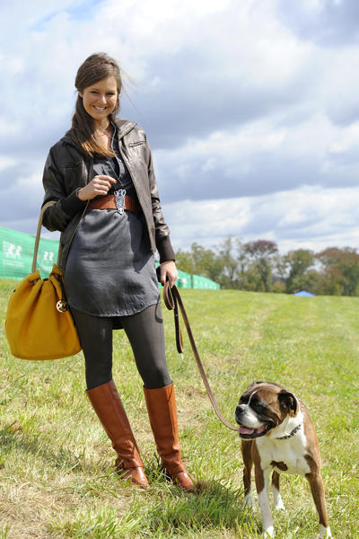 "Megan Jones, 27, found the perfect accessory for her look at the Legacy Chase at Shawan Downs: Mandy, a 6-year-old boxer belonging to a friend of hers. That only completed a style the client relations director for the Team Valor International horse-racing stables calls ""earthy, outdoors and fairly practical."" She started with a charcoal Banana Republic silk tunic/dress over brown herringbone tights from Nordstrom and tobacco Coach riding boots from Nordstrom. The Oxford, Penn., resident added a tobacco belt with zebra head buckle from Anthropologie, a brown leather EMU bomber jacket she found at a saddlery in Saratoga Springs, New York, and a mustard Michael Kors tote from Nordstrom. The secret to her style? ""I like good boots, purses and jackets,"" she say. ""Then, I fill in everything else."""