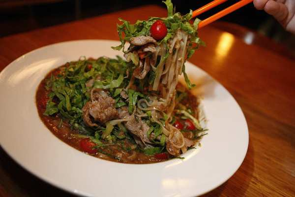 Satay noodles come with Niman Ranch beef, dried shrimp, eye-wateringly strong shrimp paste ... and a warning.