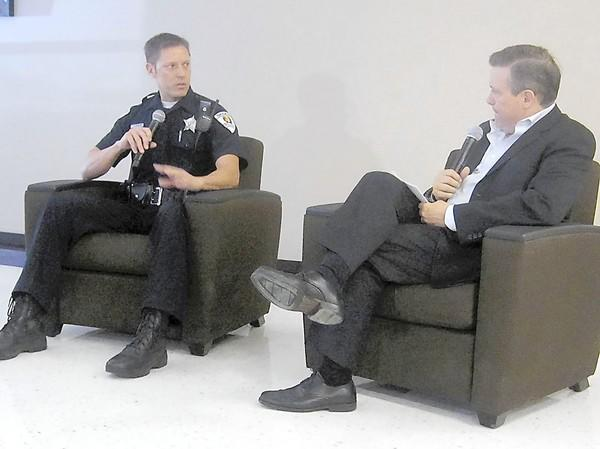 Skokie Police Officer Eric Swaback is interviewed, talk show-style, during a presentation on the dangers of distracted driving Oct. 5 at Niles North High School in Skokie.