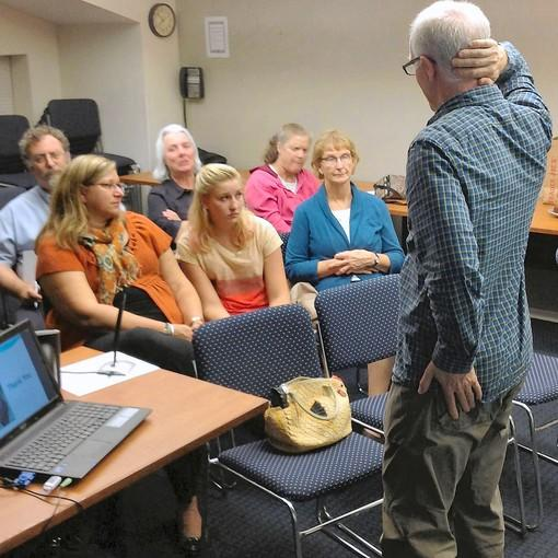 Kevin Q. Harvey speaks to people about his proposal that Glencoe allows backyard chickens.