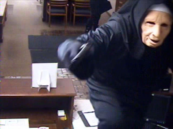 Surveillance photo from 2011 bank heist in Palos Heights during which two robbers wore nun habits and masks.