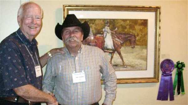 "Burbank artist Cliff Barnes, left, is congratulated by John Coleman, show judge and member of the Cowboy Artists of America. The American Plains Artists selected Barnes' watercolor ""Riding Proud"" as Best of Show at its 28th annual Juried Exhibit & Sale at the Museum of the Southwest in Midland, Texas."