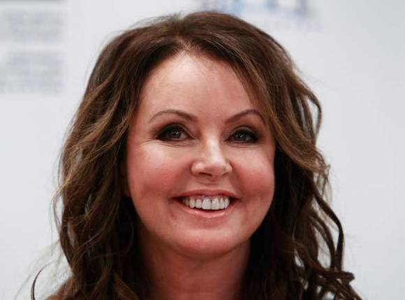 British singer Sarah Brightman smiles during a news conference in Moscow