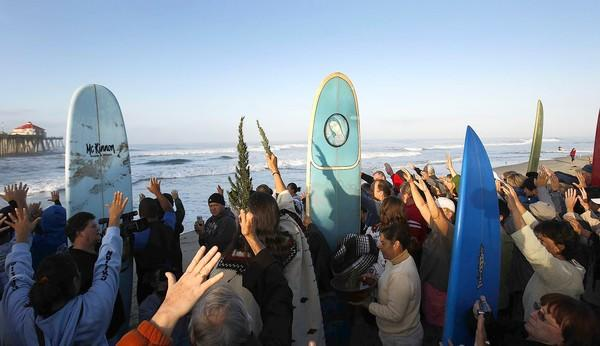 The faithful join a variety of spiritual leaders in the Blessing of the Waves ceremony at the pier in Huntington Beach in 2008.