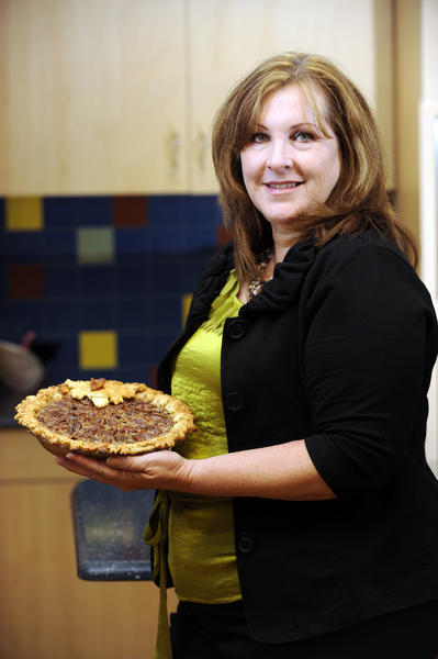 Cynthia Lorow, Weston, poses with her Maple Bacon Pecan Pie Caramel Pecan Apple Pie  during the Sun Sentinel Blue Ribbon Thanksgiving Bake-Off at Publix in Plantation. Photo by Josh Ritchie