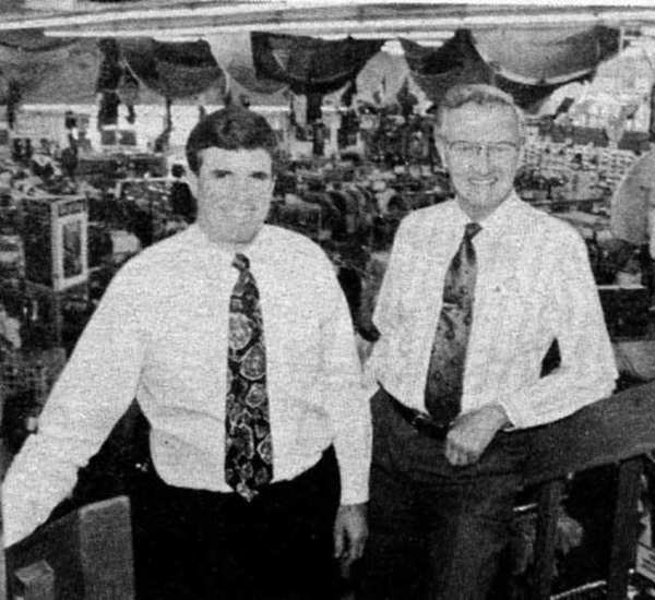 Sam Allen, left, then president and chief executive of Sport Chalet, Inc., stands with the chains founder, Norbert Olberz, when the announcement was made 20 years ago this week that the company had filed with the U.S. Securities and Exchange Commission for an initial public offering of 1.6 million shares of common stock.