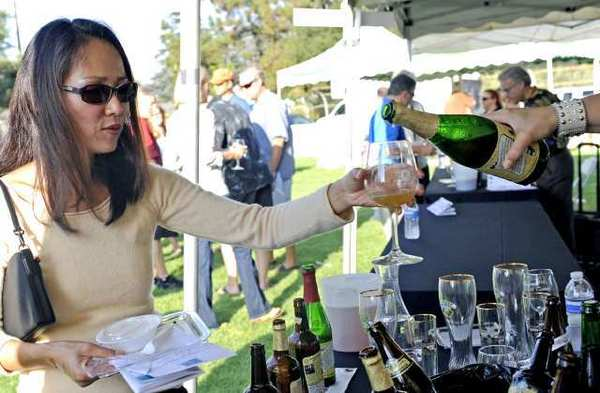 Guests sample gourmet food and wines during the La Canada Flintridge 10th Annual Wine and Gourmet Food Tasting sponsored by the Kiwanis Club of La Canada, La Canada Flintridge Educational Foundation Endowment Fund, LCF Chamber of Commerce, and Le Petit Vendome at Memorial Park on Sunday.