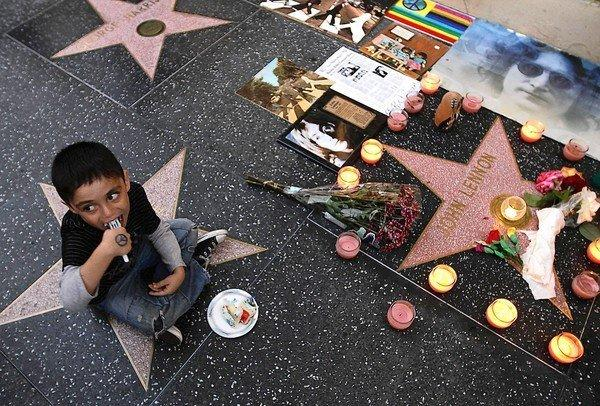 Lennon Lopez, 5, eats cake as dozens of fans gather at John Lennon's star on the Hollywood Walk of Fame on the singer's birthday.