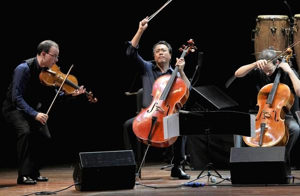 The Silk Road Ensemble members (left to right): Viola player Nicholas Cords, cello player Yo-Yo Ma and cello player Mike Block perform at Ravinia Festival in Highland Park.